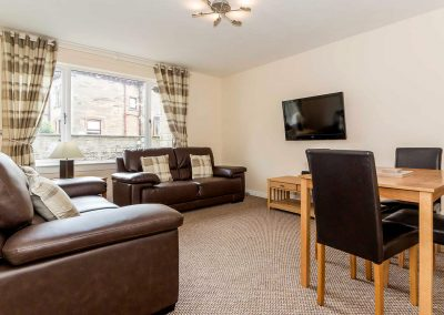 Beautiful lounge with dining area in one of our 2 bedroomed apartments within Grangelea Court. Flat screen tv and free wifi available in all apartments – available to let at Grangemouth Property Lets.